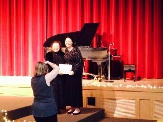 Kristen Stieffel presents Jericha Kingston her award certificate at the Florida Christian Writers Conference. Photo courtesy Jericha Kingston.